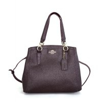 Coach Minetta crossbody in Crossgrain leather - Coklat