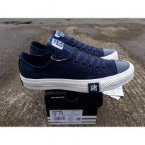 converse low undefeated dress blue