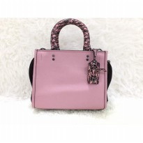 COACH ROGUE 25 IN GLOVETANNED PEBBLE LEATHER WITH COLORBLOCK SNAKE PINK