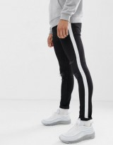 ASOS DESIGN super skinny in black with white sidestripe and knee rips